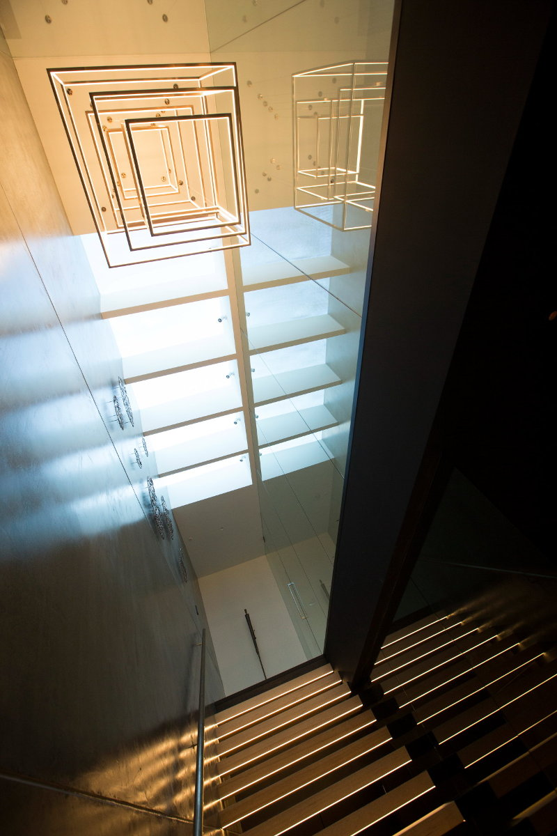lighting feature and staircase with each step lit from below